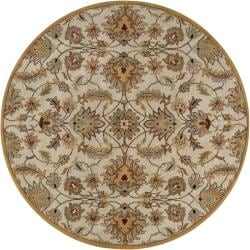 Hand-tufted Stage Gold Wool Rug (9'9 Round)