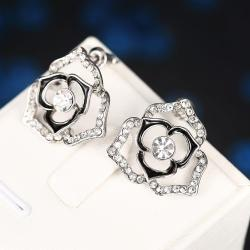 18K White Gold Hollow Floral Earrings Made with Swarovksi Elements only only from Rubique Jewelry Jewelry